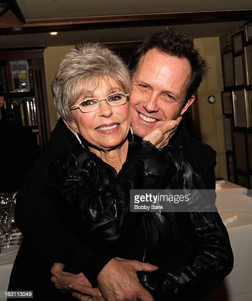 Rita Moreno and actor Dean Winters attend the Rita Moreno A Memoir Book Release Party on March 4 2013 in New York City