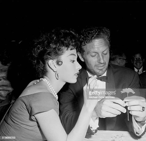 Rita Moreno and Robert Stack attend a party at Ciro's in Los AngelesCA