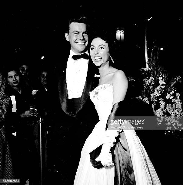 Rita Moreno and Robert Wagner attend the movie premiere of Grey Flannel Suit in Los AngelesCA