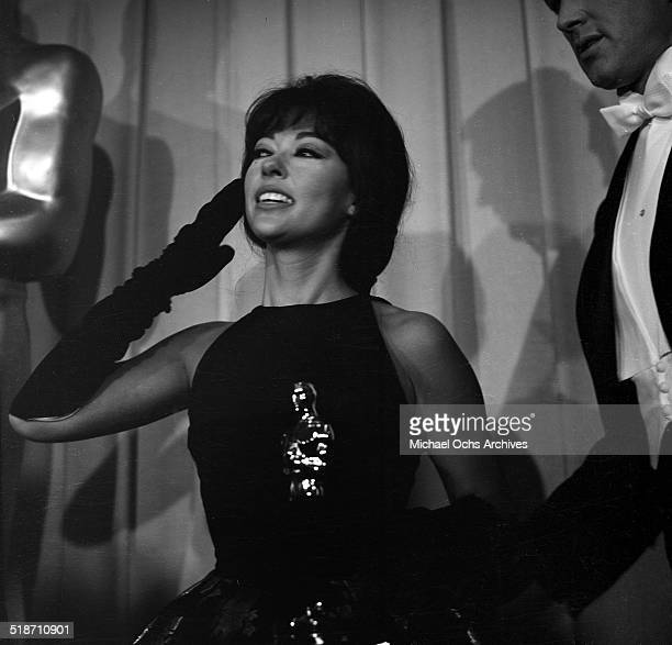 Rita Moreno holds her Oscar during the Academy Awards after winning for 'West Side Story' in Los AngelesCA