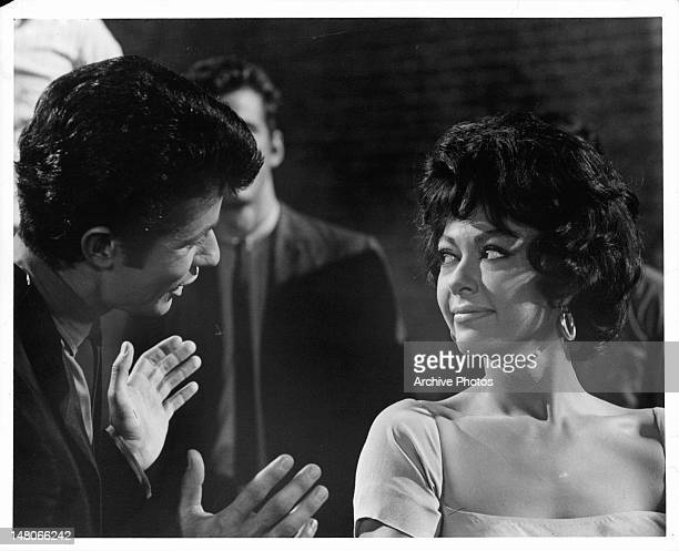 Rita Moreno listens while George Chakiris speaks with her in a scene from the film 'West Side Story' 1961