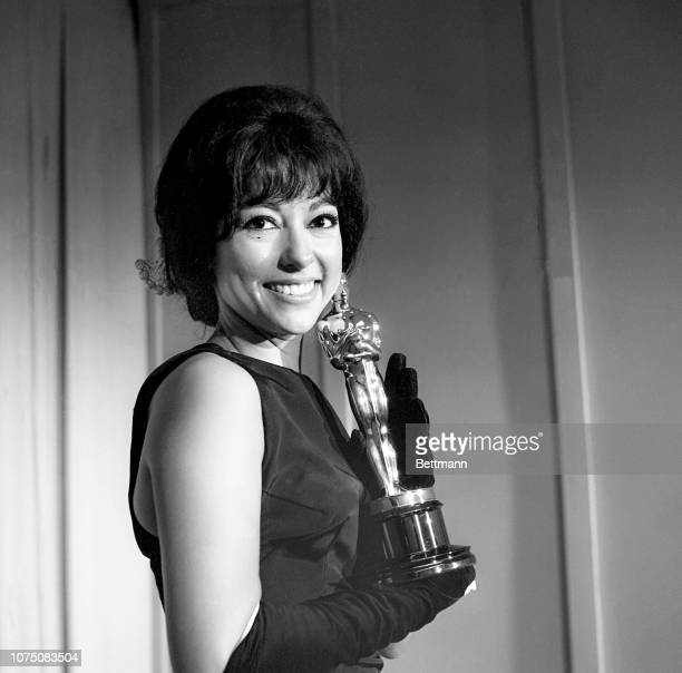 """Rita Moreno poses with her Oscar after she was named """"Best Supporting Actress"""" for her role in """"West Side Story."""""""