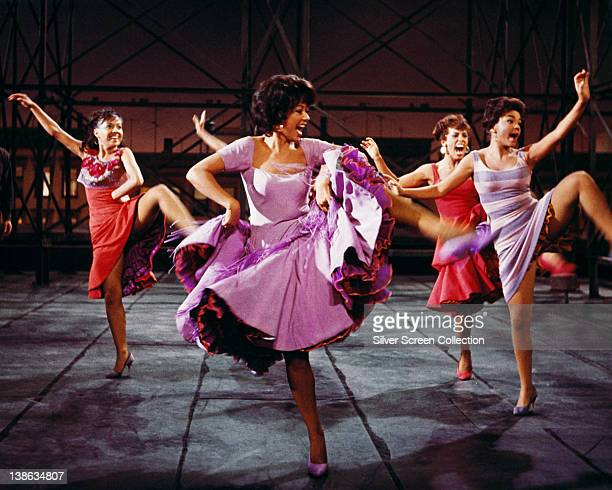 Rita Moreno Puerto Rican actress singer and dancer wearing a shortsleeved lilac dress dancing in a publicity image issued for the film adaptation of...