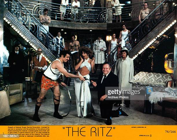Rita Moreno reacts as man points gun at Jack Weston in a scene from the film 'The Ritz', 1976.