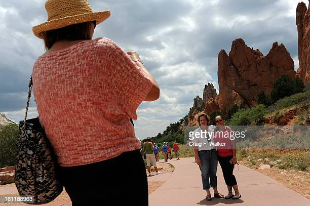 Rita Nickels and Kristina McSwain right have their picture made while visiting the Garden of the Gods in Colorado Springs CO Friday July 06 2012...