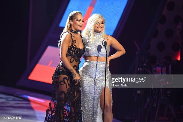 Rita Ora and Bebe Rexha speak onstage during the 2018 MTV Video Music Awards at Radio City Music Hall on August 20, 2018 in New York City.