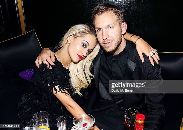 Rita Ora and Calvin Harris attend the Three Six Zero and Nokia MixRadio Party at Hakkasan on February 19 2014 in London England