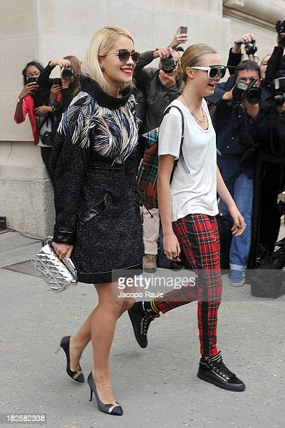 Rita Ora and Cara Delevingne leave the Chanel Fashion Show during Paris Fashion Week Womenswear SS14 Day 8 on October 1 2013 in Paris France