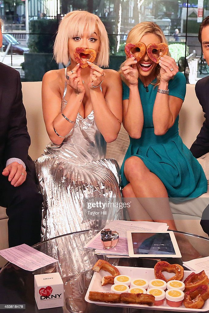 Rita Ora and Elisabeth Hasselbeck have fun with cronuts on 'Fox & Friends' at the FOX Studios on August 19, 2014 in New York City.