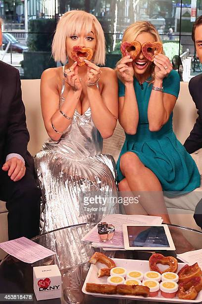 Rita Ora and Elisabeth Hasselbeck have fun with cronuts on Fox Friends at the FOX Studios on August 19 2014 in New York City