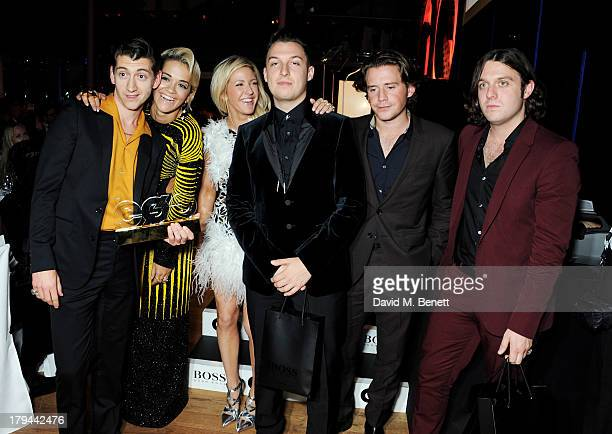 Rita Ora and Ellie Goulding pose with Best Band winners Alex Turner Matt Helders Jamie Cook and Nick O'Malley of The Arctic Monkeys attend the GQ Men...