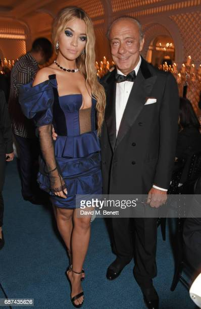 """Rita Ora and Fawaz Gruosi attend the de Grisogono """"Love On The Rocks"""" party during the 70th annual Cannes Film Festival at Hotel du Cap-Eden-Roc on..."""