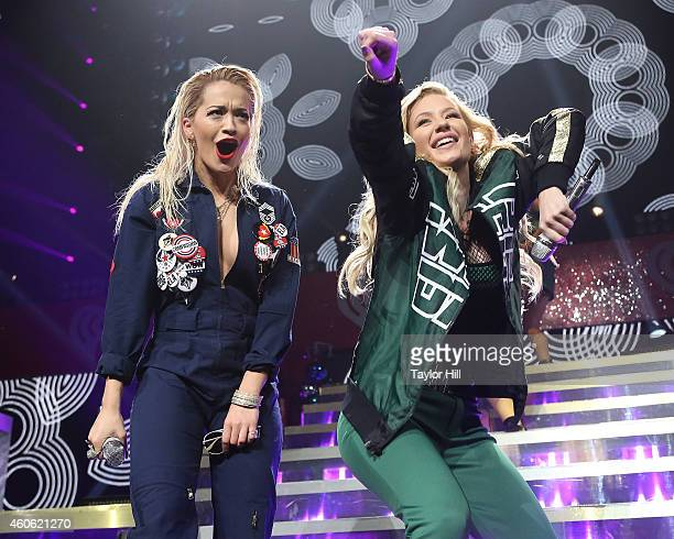 Rita Ora and Iggy Azalea perform at the 2014 Hot 995 Jingle Ball at Verizon Center on December 15 2014 in Washington DC