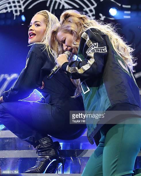 Rita Ora and Iggy Azalea perform at the 2014 Hot 995 Jingle Ball at Verizon Center on December 15 2014 in Washington DC
