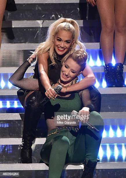 Rita Ora and Iggy Azalea perform onstage during iHeartRadio Jingle Ball 2014 hosted by Z100 New York and presented by Goldfish Puffs at Madison...
