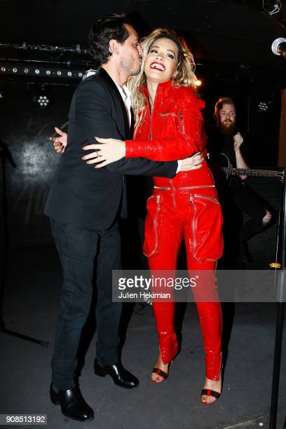 Rita Ora and Kilian Hennessy are pictured on stage during the Kilian Party as part of Paris Fashion Week on January 21 2018 in Paris France