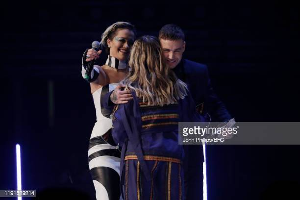 Rita Ora and Liam Payne present the British Emerging Talent for Menswear Award to Bethany Williams on stage during The Fashion Awards 2019 held at...