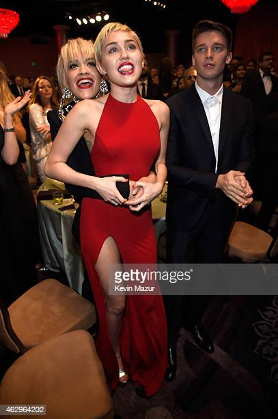 Rita Ora and Miley Cyrus attend the PreGRAMMY Gala And Salute To Industry Icons Honoring Martin Bandier at The Beverly Hilton on February 7 2015 in...