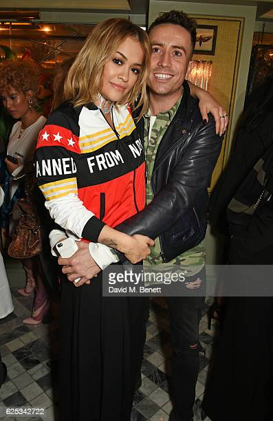 Rita Ora and Nick Grimshaw attend the adidas Originals by Rita Ora dinner at The Ivy Chelsea Garden on November 23 2016 in London England