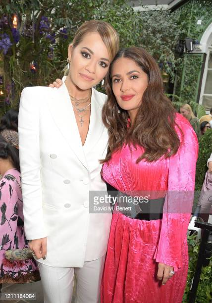 Rita Ora and Salma Hayek Pinault attend International Women's Day for The Caring Foundation with Salma Hayek at Annabel's on March 08, 2020 in...