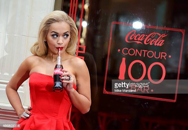 Rita Ora attends photocall to celebrates 100 years of the CocaCola Contour Bottle at the CocaCola Contour Centenary Bar on March 19 2015 in London...