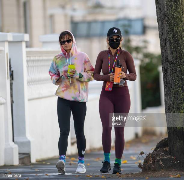 Rita Ora heads to the gym with a friend on October 5, 2020 in London, England.