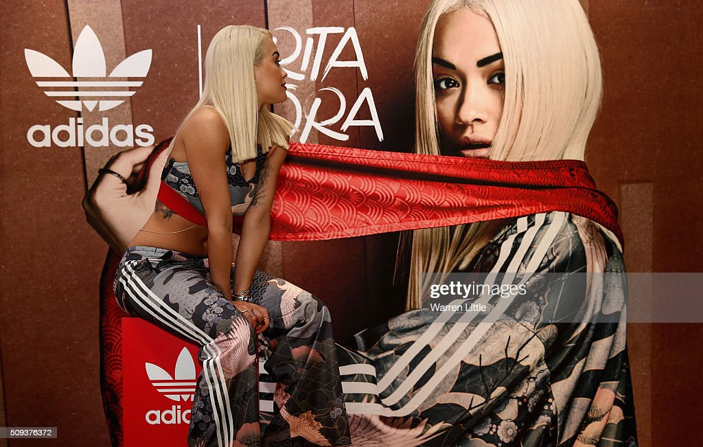 Rita Ora poses for a picture as she launches her adidas Originals Rita Ora SS16 collection at the Originals store at Dubai Mall on February 10, 2016 in Dubai, United Arab Emirates.