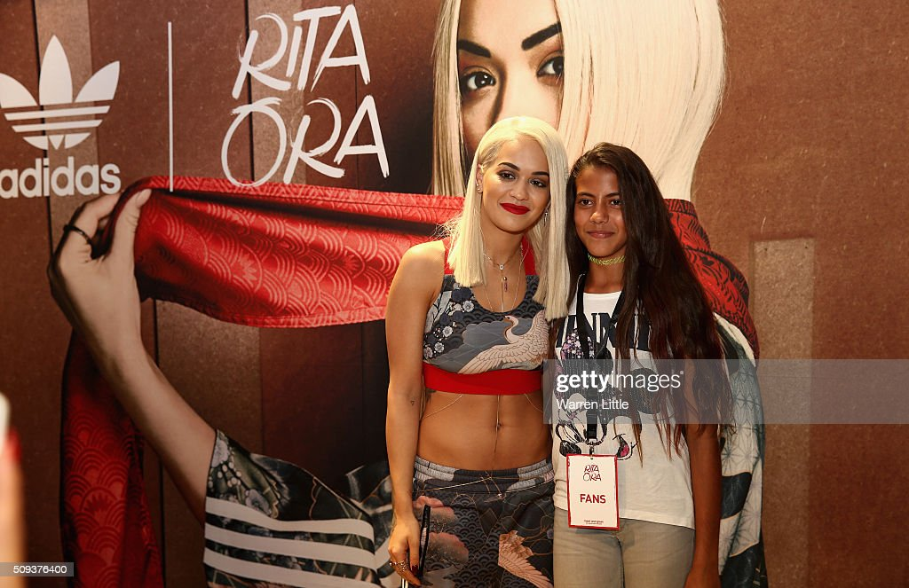 Rita Ora poses for a picture with a fans as she launches her adidas Originals Rita Ora SS16 collection at the Originals store at Dubai Mall on February 10, 2016 in Dubai, United Arab Emirates.