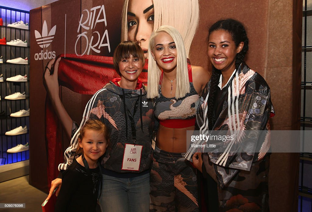Rita Ora poses for picture with fans as she launches her adidas Originals Rita Ora SS16 collection at the Originals store at Dubai Mall on February 10, 2016 in Dubai, United Arab Emirates.