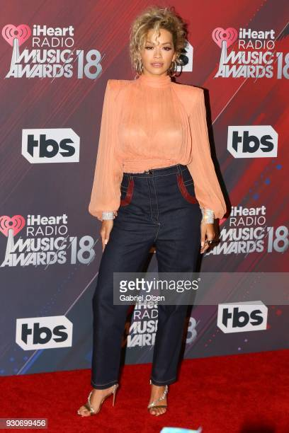 Rita Ora poses in the press room at the 2018 iHeartRadio Music Awards at The Forum on March 11 2018 in Inglewood California