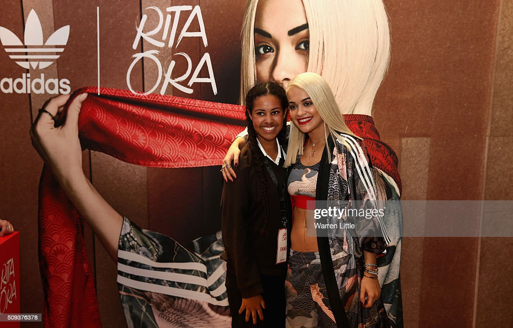 Rita Ora poses with fan, Bethany starr as she launches her adidas Originals Rita Ora SS16 collection at the Originals store at Dubai Mall on February 10, 2016 in Dubai, United Arab Emirates.
