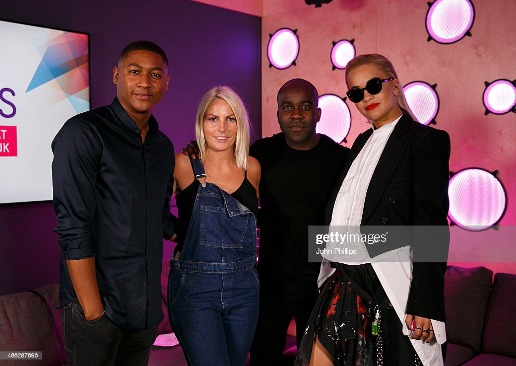 Rita Ora poses with KISS Breakfast presenters Rickie Haywood Williams, Charlie Hedges and Melvin O'Doom as she visits Kiss FM Studio's on September 3, 2015 in London, England.