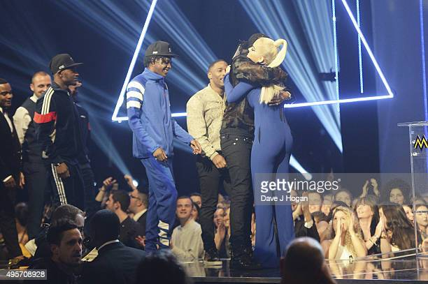 Rita Ora presents Casyo Johnson and Karl Wilson of Krept and Konan the award for Best Hip Hop Act during the MOBO Awards at First Direct Arena on...