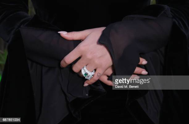 Rita Ora ring detail poses ahead of her performance in the de Grisogono showroom Terrace 'Les Oliviers' at the Martinez Hotel during the 70th Annual...