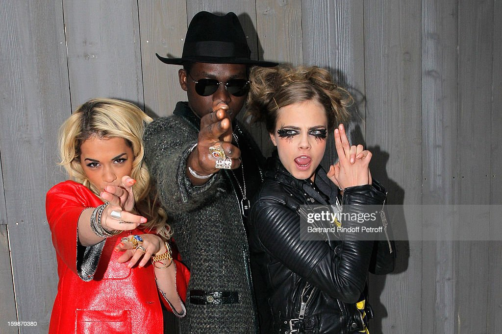 Rita Ora, Theophilus London and Cara Delevingne pose as they arrive to attend the Chanel Spring/Summer 2013 Haute-Couture show as part of Paris Fashion Week at Grand Palais on January 22, 2013 in Paris, France.