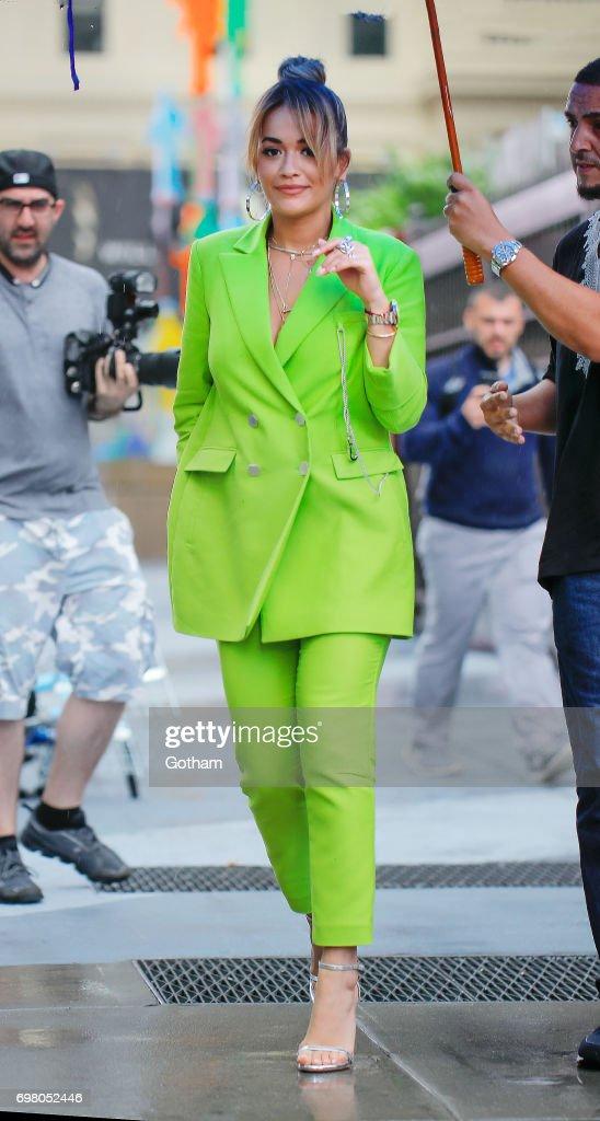 Rita Ora walks under the umbrella in the rain on June 19, 2017 in New York City.