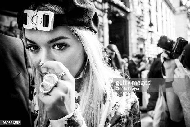 Rita Ora, wearing Dior black cap, Dior ring and floreal shirt, is seen in the streets of Paris after the Dior Homme show, during Paris Men's Fashion...