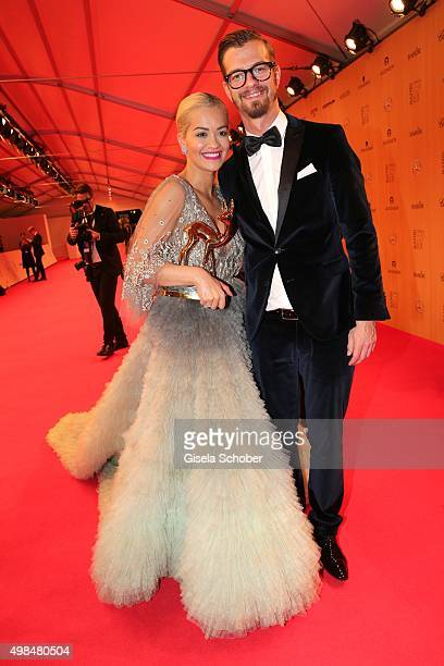 Rita Ora with award and Joko Winterscheidt during at the Bambi Awards 2015 winners board at Stage Theater on November 12 2015 in Berlin Germany