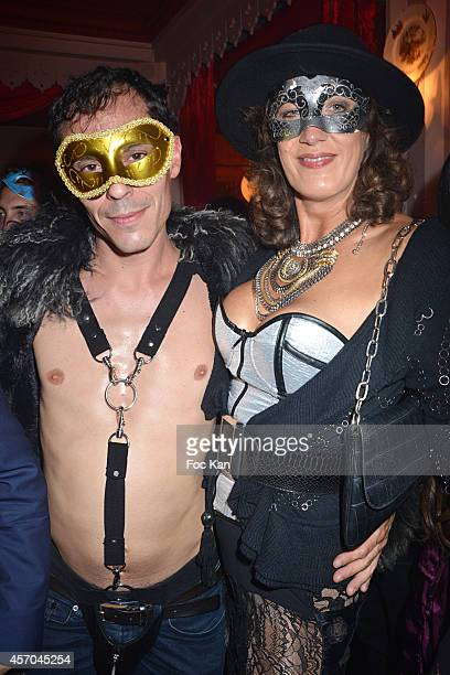 Rita Sprickmann and a guest attend the Marc Dorcel 35th Anniversary Masked Ball at the Chalet des Iles on October 10 2014 in Paris France