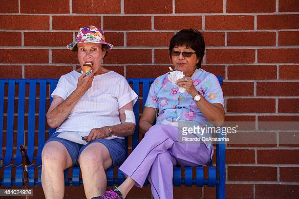 Rita Title Lt and companion Win Ledesma eat ice cream in the shade at Cheviot Hills Community Center August 13 2015 in West Los Angeles California