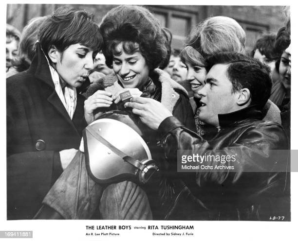 Rita Tushingham is the center of all eyes as boyfriend Colin Campbell gives her a token of his affection in a scene from the film 'The Leather Boys'...