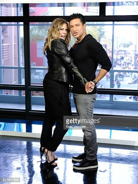 Rita Wilson and Mario Lopez dance together at 'Extra' at Universal Studios Hollywood on March 28 2016 in Universal City California