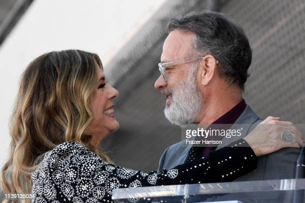 Rita Wilson and Tom Hanks embrace as Wilson is honored with a star on the Hollywood Walk of Fame on March 29 2019 in Hollywood California