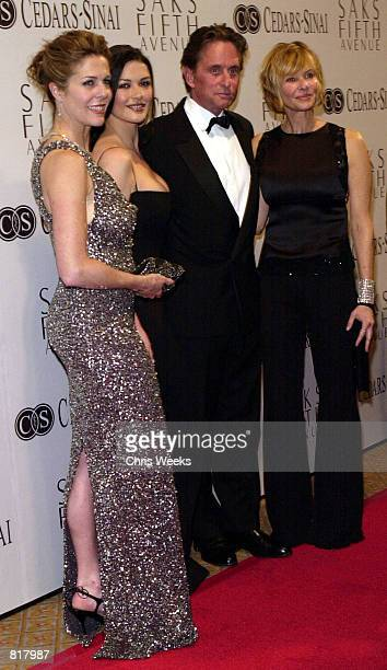 Rita Wilson Catherine ZetaJones her husband Michael Douglas and Susan Sarandon pose for photographers while they arrive at An Unforgettable Evening...