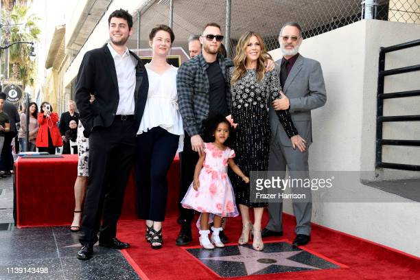 Rita Wilson stands next to her star along with Tom Hanks Truman Hanks and Chet Hanks as she is honored on the Hollywood Walk of Fame on March 29 2019...