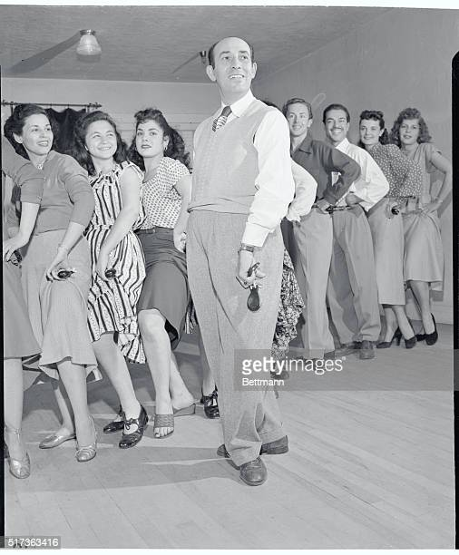 Rita's Dad Teaches Dancing Los Angeles Teaching dancing to a class in his Los Angeles studio is Eduardo Cansino father of screen star Rita Hayworth...