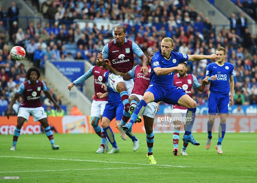 Ritchie De Laet of Leicester City beats Gabriel Agbonlahor and Leandro Bacuna of Aston Villa to score their first goal during the Barclays Premier League match between Leicester City and Aston Villa at the King Power Stadium on September 13, 2015 in Leicester, United Kingdom.