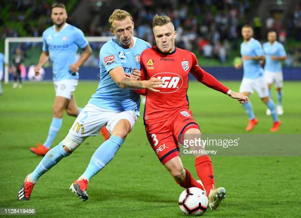 Ritchie De Laet of Melbourne City and Scott Galloway of Adelaide United compete for the ball during the round 18 A-League match between Melbourne...