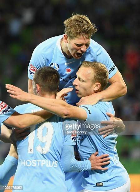 Ritchie De Laet of Melbourne City is congratulated by team mates after scoring a goal during the round four ALeague match between Melbourne City and...
