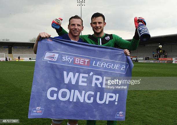 Ritchie Humphrey's and Tommy Lee of Chesterfield celebrate their promotion during the Sky Bet League Two match between Burton Albion and Chesterfield...